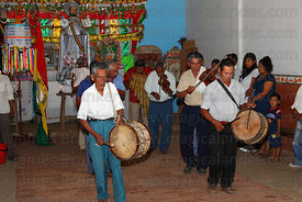 Musicians paying respect to San Ignacio in the Mojeño Cabildo (parliament) building, San Ignacio de Moxos, Bolivia