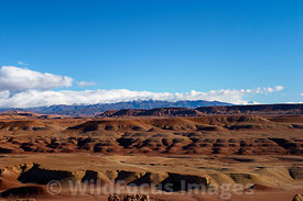View of the snow covered peaks of the Atlas Mountains from the fortified granary atop Ait Benhaddou, Morocco; Landscape