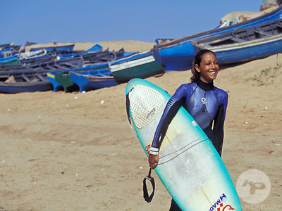 Moroccan Female surfers riding waves in Morocco