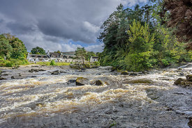 The river Dochart in spate as it crashes over the Falls of Dochart in Killin, Pertshire, Scotland.