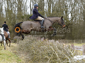 Phoebe Buckley jumping a hedge at Orton Park