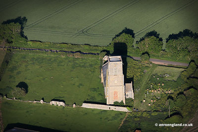aerial photo of  St John the Evangelist.Church Waxham  Norfolk England UK.