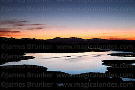 Lake in bofedales near Parinacota village after sunset, Lauca National Park, Region XV, Chile