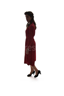 A semi-silhouette of a 1940's woman in a red dress walking – shot from eye-level.