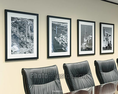 Black & white photography on exhibit as framed art  in offic conference room