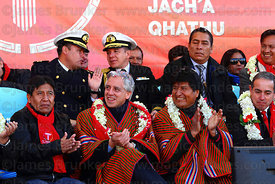 Bolivian president Evo Morales (left) and vice president Alvaro Garcia Linera (centre) applaud during the cable car Red Line inauguration ceremony , La Paz, Bolivia