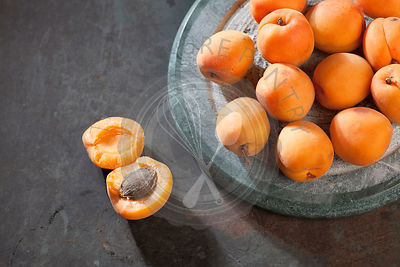 Apricots. Bowl of harvested apricots  for jam on a rustic metal surface