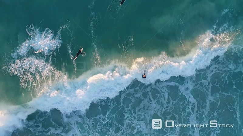 Top Down view of Surfers riding big waves in Perth Australia