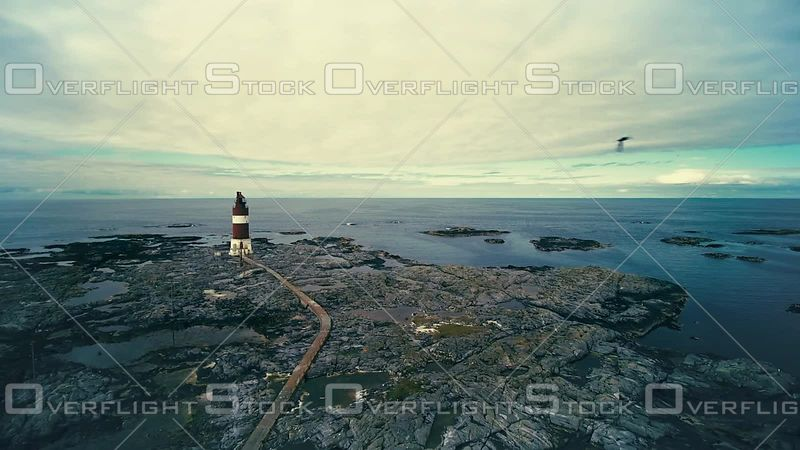 Navigation Lighthouse on a Rocky Coastline of Norway