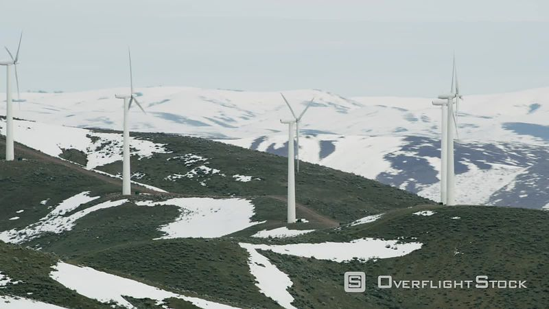 Aerial view of wind turbines in winter