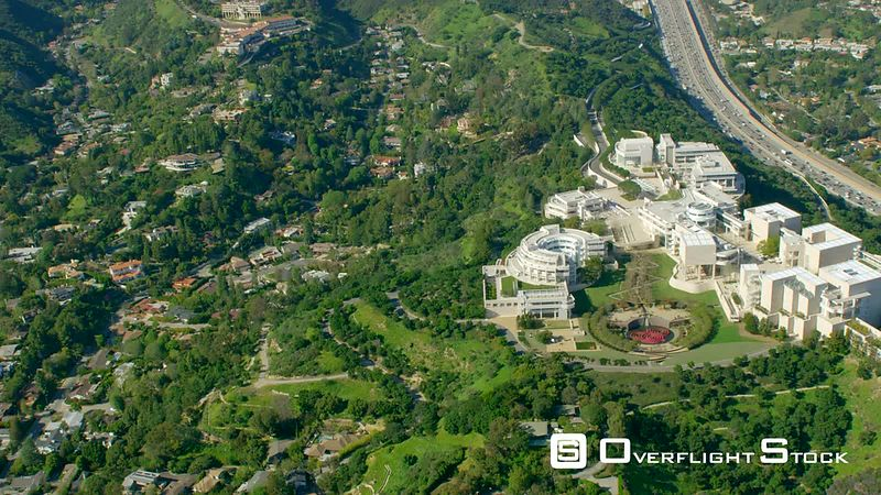 Red Epic Video The Getty Museum Los Angeles California USA. also showing the 405 freeway, notorious for its traffic jams sometimes referred to as 'the world's biggest parking lot'. Extremely rare view of the area with lush green vegetation after winter rains!