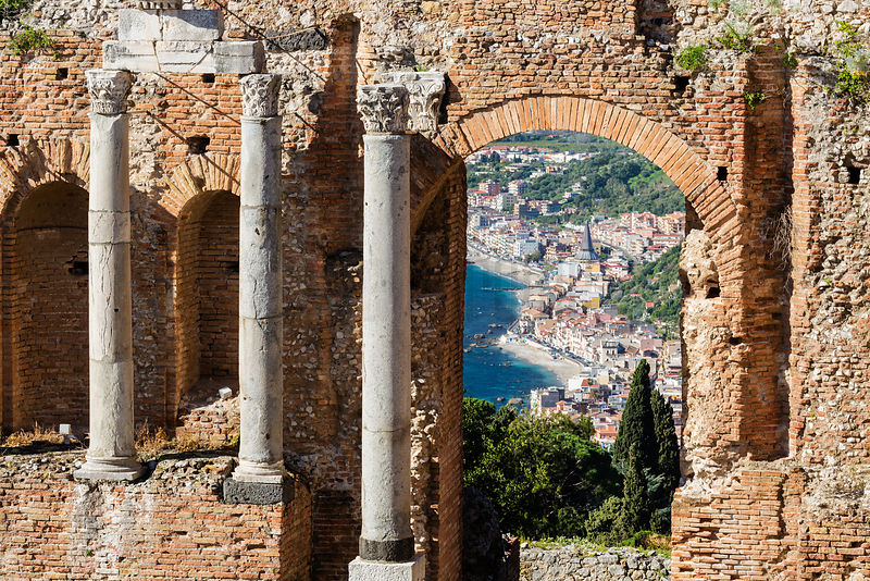 The Town of Taormina Seen through an Arch of the Ancient Greek Theatre