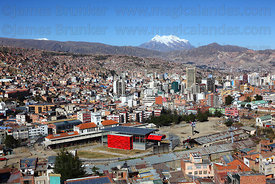 Red Line cable car terminal behind old central train station , Mt Illimani in background , La Paz , Bolivia