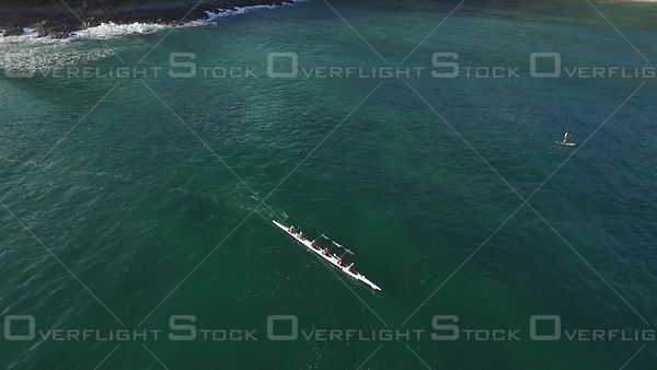 Outrigger crew taking a rest Noosa Australia