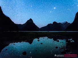 Milford Sound at night under a starry sky, New Zealand