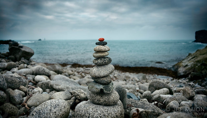 Cairn (rock pile) on peeble beach