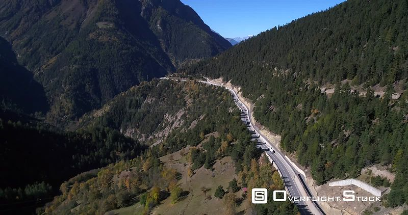 Cars on an alpine mountain road, on a sunny fall day, on Simplon Pass, in Wallis, of the Alps in Switzerland