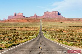 Empty road leading to Monument Valley, Arizona, USA