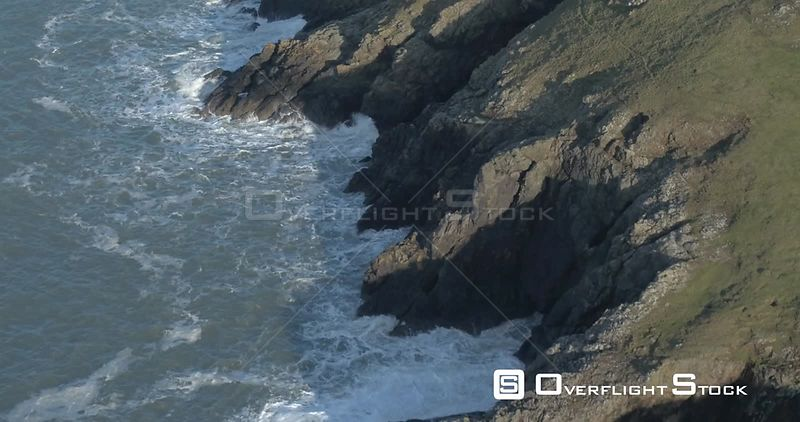 Aerial shot tracking over sea cliffs, Pembrokeshire, Wales, UK, January 2017.