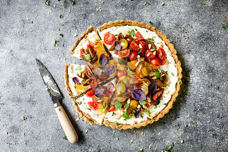 Heirloom Tomato Ricotta Tart on a gray background