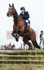 Meghan Healy Jumping a hunt jump at Newbold. The visit of the Wynnstay Hounds to the Cottesmore 27/11