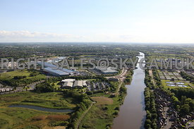 Manchester aerial photograph showing the distant horizon and a wide angle landscape view of the Manchester Ship Canal looking west with the M60 motorway crossing the Barton Bridge