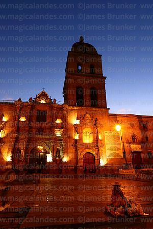 Street vendor in front of San Francisco church at sunset, La Paz, Bolivia