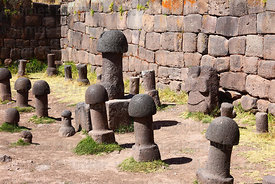 Stone phalluses in Inca Uyo fertility temple at Chucuito , near Puno , Peru