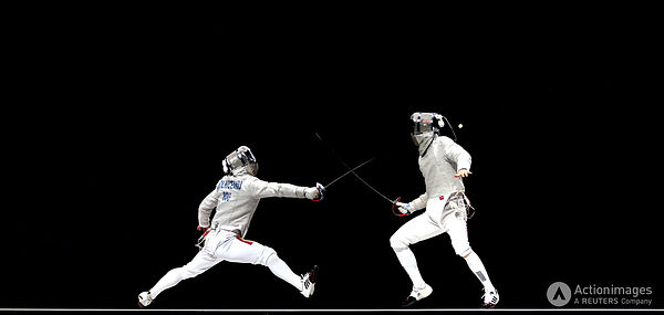 Olympics - London 2012 Olympic Games - ExCel - 3/8/12 Fencing - Men's Team Sabre - Final - Romania's Florin Zalomir (L) in action against Republic of Korea's Bongil Gu Mandatory Credit: Action Images / Steven Paston Livepic PLEASE NOTE: FOR EDITORIAL USE ONLY
