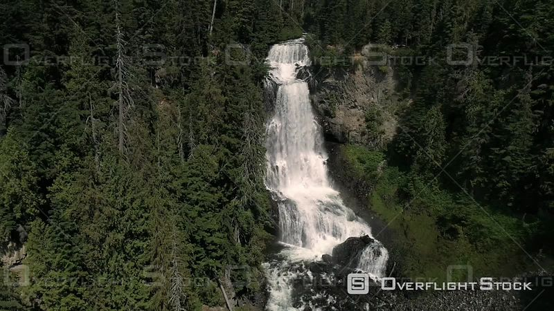 Drone flying sideways filming cascading waterfalls in Canada