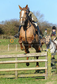 William Bell jumping a hunt jump at Burrough House
