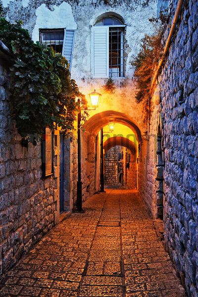 Narrow street in Safed at dusk