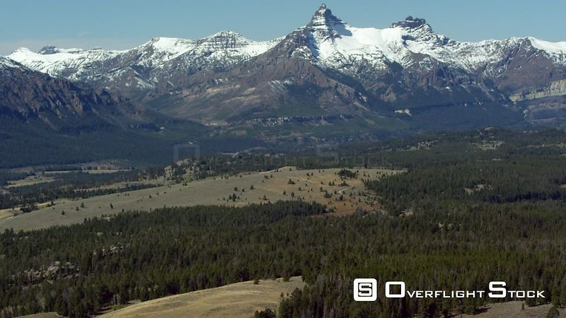Pilot Peak (Left) and Index Peak (Right) tower over the dense forests and open meadows of the Beartooth mountain range near Yellowstone National Park