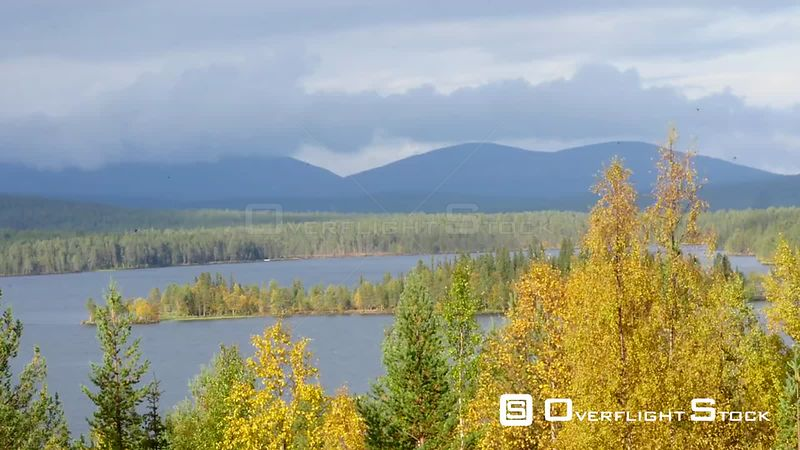 Autumn Color Landscape, Pan Time Lapse of Autumn Trees, a Lake and Fjeld Tunturi Mountains, on a Sunny and Rainy Fall Day, in Sarkijarvi, Near Pallasyllas National Park, Lapland, Finland