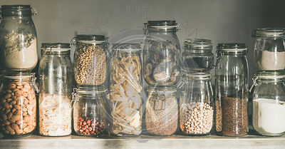 Rustic kitchen food storage arrangement in glass jars