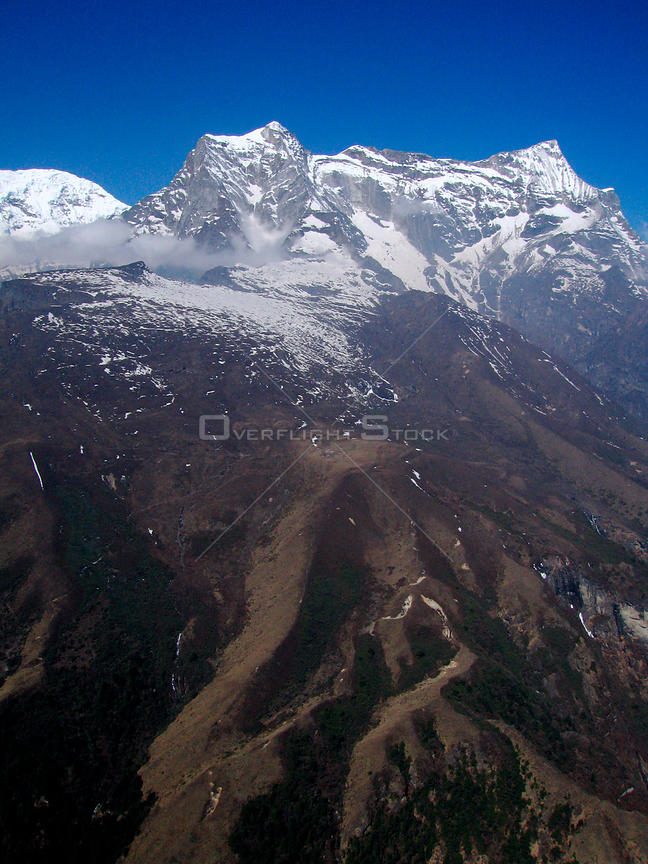 NEPAL Mount Nupla -- 16 Apr 2005 -- Aerial photograph of Mount Nupla, which is 5,885m high and dominates the view from nearby Namche Bazaar