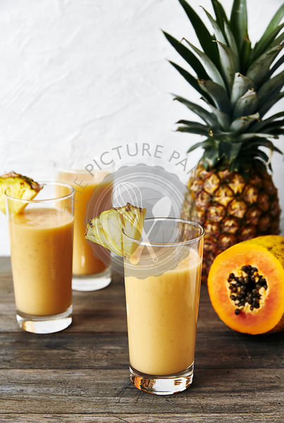 Healthy tropical fruit smoothie: coconut water, pineapple, pawpaw, banna