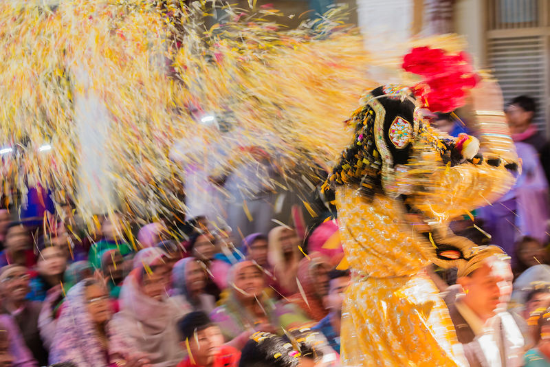 Lord Krishna Throwing Flowers at Holi Celebration