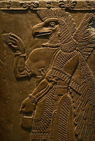 Sculptured wall relief depicting an Eagle headed protective Spirit from Temple of Ninurta at Nimrud the Assyrian capital in Northern Iraq, dates from 865 -860 BC