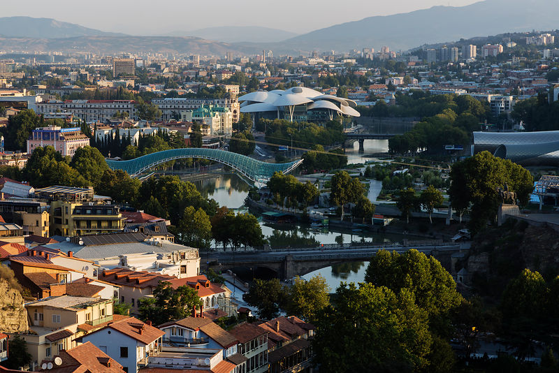 View of Tbilisi looking towards Metekhi bridge and Church, Peace bridge and the Public Service Building