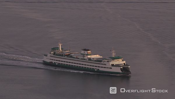 Seattle, Washington Aerial view of ferry in Puget Sound by Seattle at sunrise.  Shot with Cineflex and RED EpicW Helium.