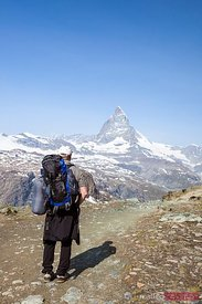 Hiker looking at Matterhorn mountain peak, Zermatt, Switzerland