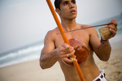 Brazil - Rio - A Capoeirista plays the Berimbau on Leblon beach