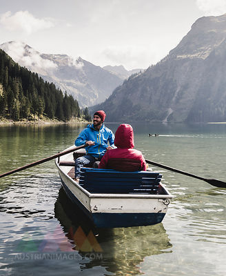 Austria, Tyrol, Alps, couple in rowing boat on mountain lake