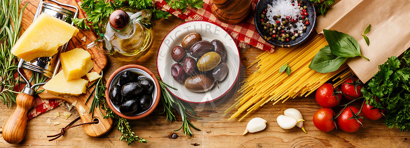 Italian food ingredients and snacks on wooden background