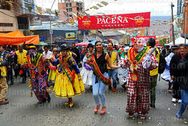 The official Ch'uta, cholita, pepino and a beauty queen dancing during parades for the Entierro del Pepino, La Paz, Bolivia