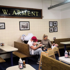 A family in Arments Pie and Mash shop, London