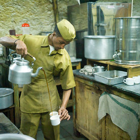 A worker pours tea in the kitchen of the Indian Coffee House, Shimla