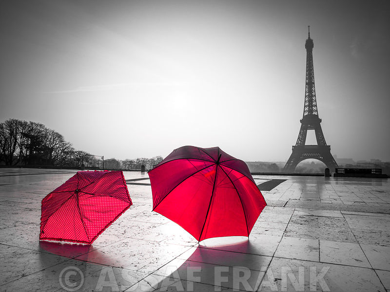 Two Umbrellas in front of the Eiffel tower, Paris, France