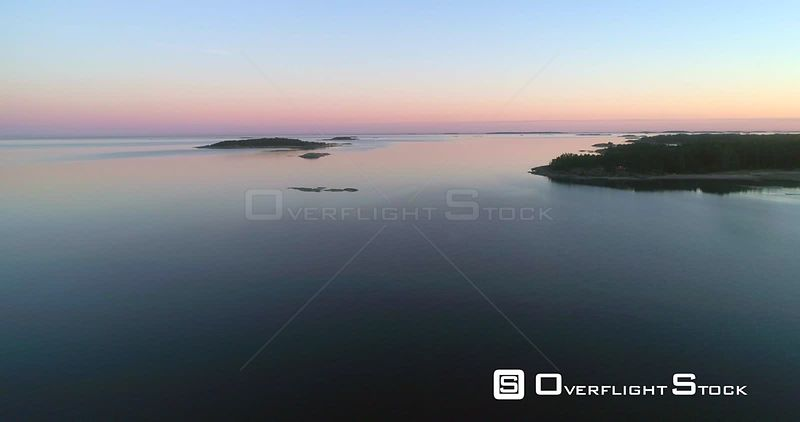 Calm sea at dusk, aerial view of calm, clear and reflecting waters of the gulf of finland, on a sunny summer evening sunset, in Hanko, Finland